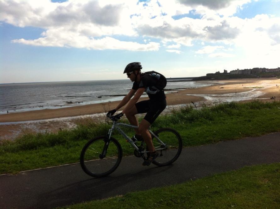 cycling along tynemouth longsands, training for the coast to coast